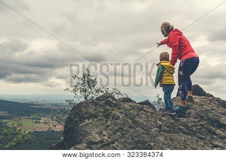 Mother With Little Boy Travelling In Mountains. Hiking Adventure With Child On Family Trip. Vacation
