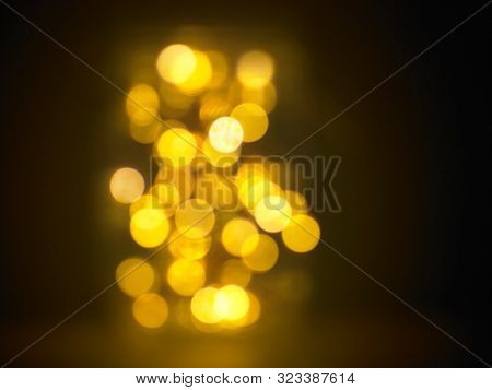 soft or out focus of glass jar full of light on dark background