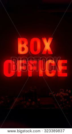 Box Office Sign With Red Light On A Wall At Night
