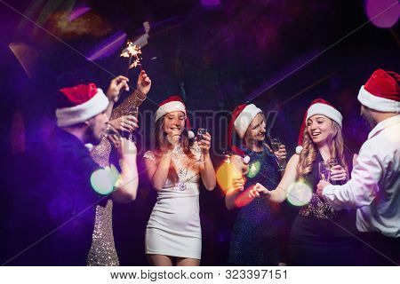 Christmas, Dance Party In Night Club, Holiday, Fun. Happy People Celebrating New Year Together. Comp