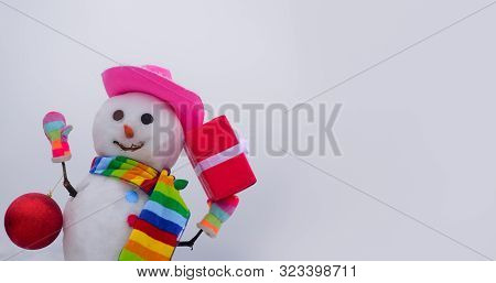 Snowman In Cap, Scarf In Winter. Christmas And Winter Fashion. Winter Holiday. Hand Made Snowman Wit