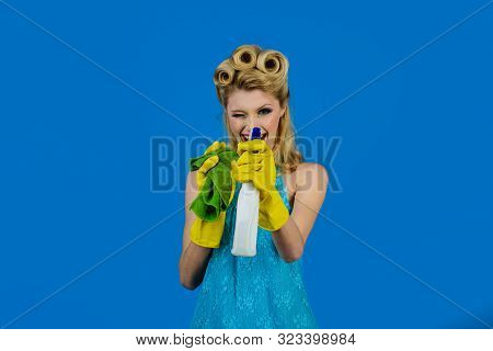 Cleaning Service. Housewife Ready For Housework. Cleaning Pin Up Woman. Beautiful Woman Holds Duster
