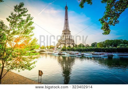 Paris Eiffel Tower And River Seine With Sunrise Sun In Paris, France. Eiffel Tower Is One Of The Mos
