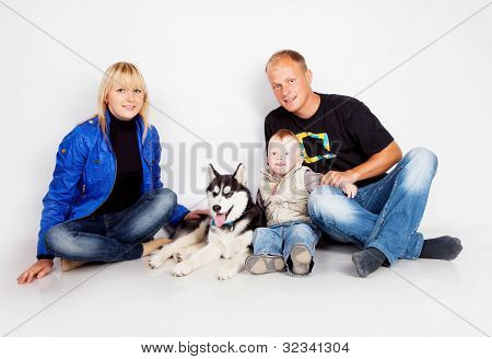 Family With Puppy Husky