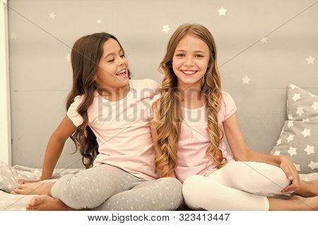 Girls Sisters Spend Pleasant Time Communicate In Bedroom. Sisters Older Or Younger Major Factor In S