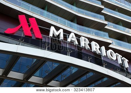 Minsk, Belarus - July, 2019. - Angular Close-up Of Marriott Hotel Logotype Above Entry To Hotel