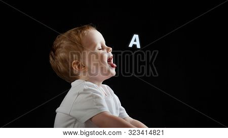 Baby Says, The Concept Of Problems With Dyslexia And Dysgraphia. A Child Learns To Speak, A Boy On A