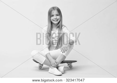 Ride Penny Board And Do Tricks. Girl Likes To Ride Skateboard. Active Lifestyle. Girl Having Fun Wit