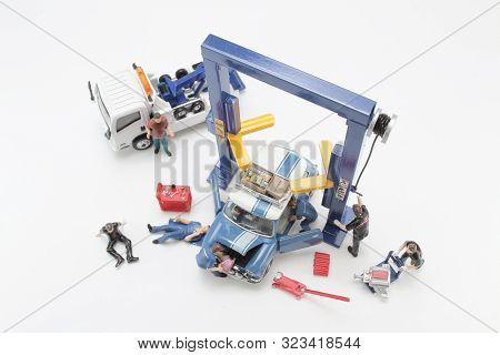 A Scale Tiny Of Model Car Lift With Figure