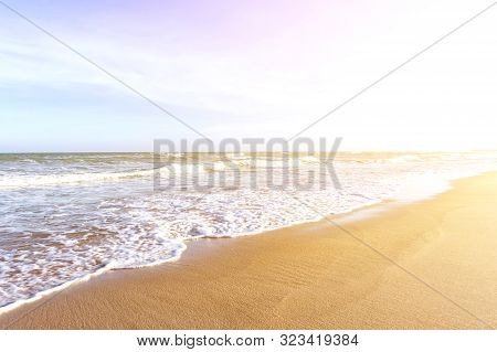 Soft Wave Of Blue Sea On Tropical Beach Abstract Texture Background