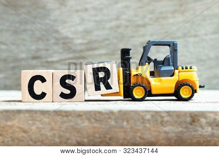 Toy Forklift Hold Letter Block R To Complete Word Csr (abbreviation Of Corporate Social Responsibili