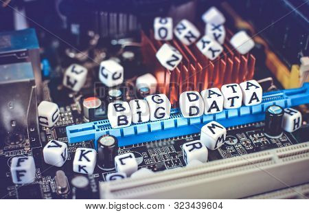 Big Data Concept With Motherboard And Cubes With Text Big Data.