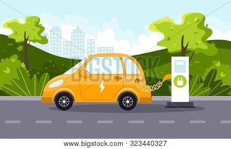 An Electric Car Charges From An Electric Vehicle Charging Station. Natural Landscape. Concept Of Pre