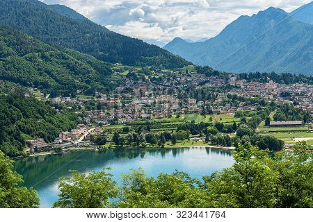 Aerial View Of The Small Town Of Levico Terme With The Lake (lago Di Levico) And The Mountains, Alps
