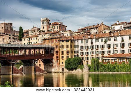The Old Town Of Bassano Del Grappa With The River Brenta And The Ponte Degli Alpini Or Ponte Vecchio