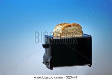 Photo Of Toaster With White Bread