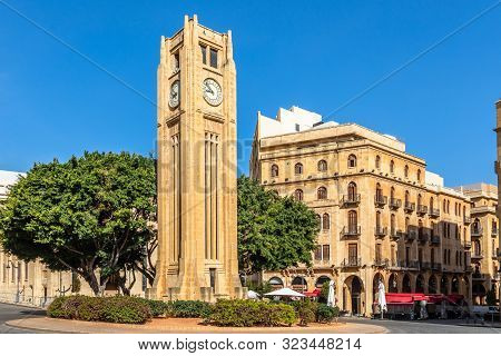 Al-abed Nejmeh Square Clock Tower With Tree And Buildings Around, Beirut, Lebanon