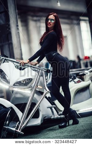 Fashionable Young Woman In Mirrored Glasses, Posing On A Custom Trike