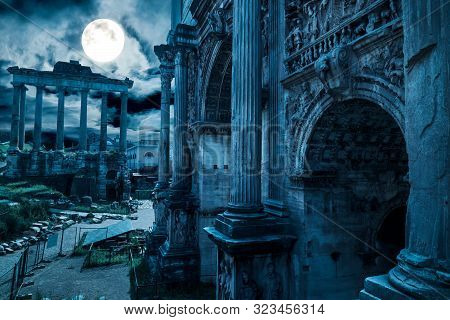 Rome At Night, Italy. Fantasy View Of Old Roman Forum, Landmark Of Rome. Mysterious Ancient Ruins Of