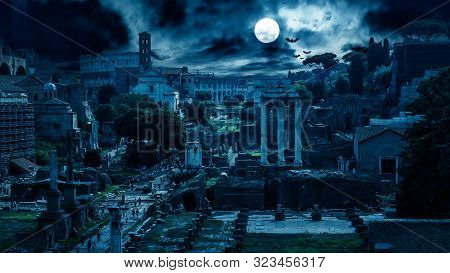 Mystery Creepy View Of Roman Forum At Night, Rome, Italy. Scary Gloomy Panorama Of Ruins Of Old Hous