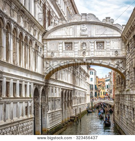 Venice, Italy - May 21, 2017: Gondolas With Tourists Sails On Old Canal Under Medieval Bridge Of Sig
