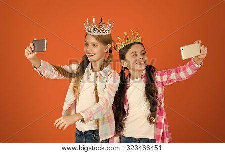 Girls Taking Selfie Photo Smartphone Camera. Spoiled Children Concept. Egocentric Princess. Kids Wea