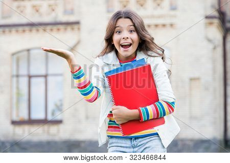 School Education. Modern Education. Kid Smiling Girl School Student Hold Workbooks Textbooks For Stu