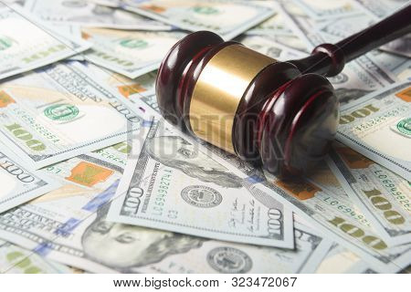 Judges Or Auctioneer Gavel On The Dollar Cash Background, Concept For Corruption, Bankruptcy, Auctio