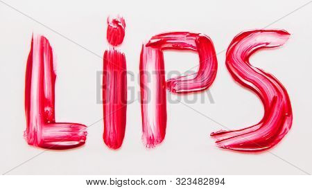Makeup Artistry. Decorative Cosmetics. Crimson Red Smeared Gloss. Lips Lettering. White Background.