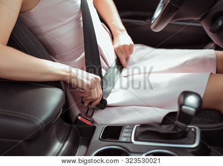 A Woman In Car Interior, Fastens Her Seat Belt, Pink Dress, Automatic Gearbox, Close-up, Safety Conc