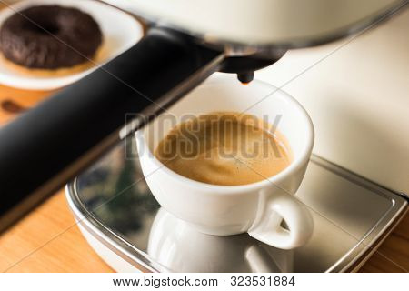 Espresso Coffee Machine And White Cup With Freshly Brewed Espresso Coffee