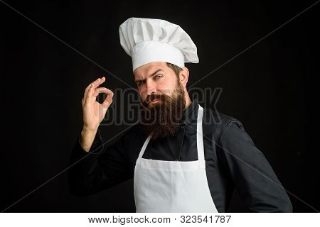 Professional Chef Man Showing Sign For Delicious. Cook With Taste Approval Gesture. Male Chef In Uni