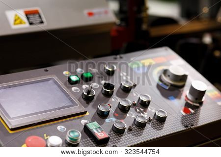Industrial Machine Remote Control Panel With Buttons, Switches And Touch Screen. Selective Focus.