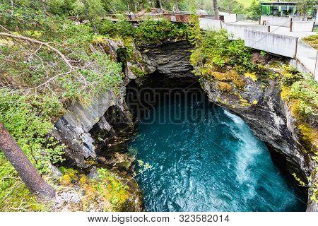 Gudbrandsjuvet Ravine And Valldola River Running Through With Waterfall, Valldal, Norway