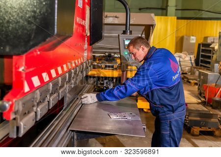 Moscow, Russia - June 18, 2019: Worker Works On A Modern Bending Machine. Cnc Equipment For High-pre