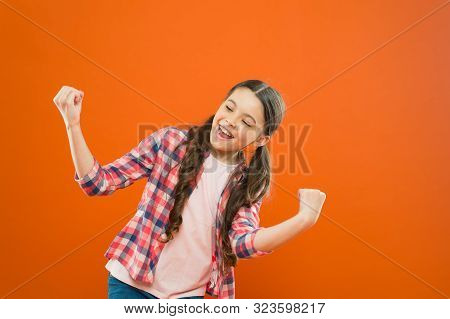 poster of celebrating success. happy childrens day. childhood happiness. little girl orange background. kid fashion. smiling school girl. worker uniform. kid long hair. small girl checkered shirt. happy child.