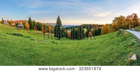 Great Rural Landscape Panorama In Mountains At Dusk. Mixed Forest On The Grassy Slopes. Old Authenti