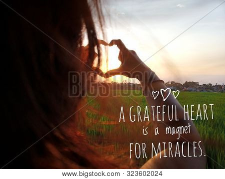 Inspirational Motivational Quote - A Grateful Heart Is A Magnet For Miracles. With Woman Making Hear