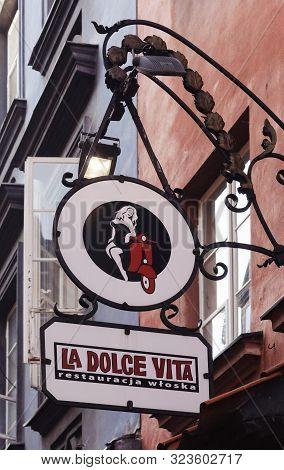 Warsaw, Poland - August 03, 2019: Dolce Vita Restaurant Sign In Old Town (stare Miasto)