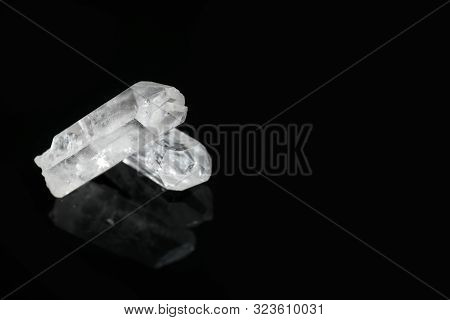Beautiful Rock Crystal Gemstones On Black Background. Space For Text