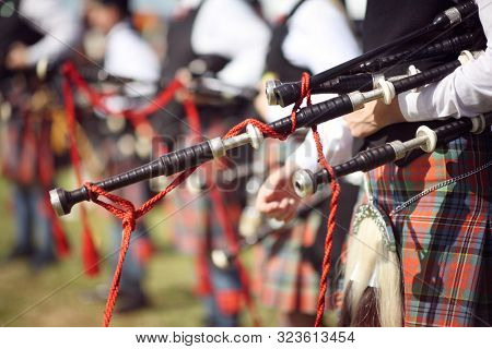 Scottish bagpipe marching band close up on bagpipes