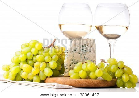 Two Glasses Of White Wine, Blue Cheese And A Grapes