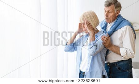 Family Disagreement. Man Consoling Senior Woman After Argument, Offended Wife