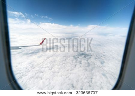 Airplane Window View To Cloudy Sky. Beautiful Landscape From Aircraft Cabin. Flying Without Incident
