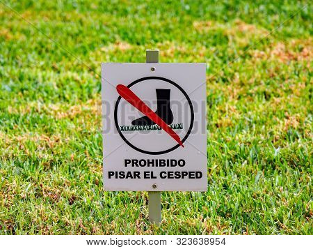 The Prohibitive Sign On The Label Do Not Walk The Lawn Closeup Against The Lawn In Sunlight