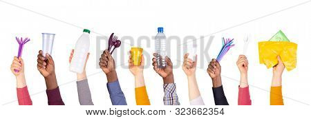 Plastic objects in hands isolated on white background