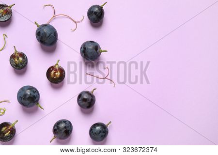 Flat Lay Composition With Fresh Ripe Juicy Grapes On Lilac Background, Space For Text