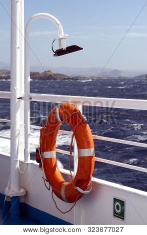 Greece, A Blowy And Stormy Day At Sea In The Aegean.  A Picture Of A Life Preserver With Choppy Seas