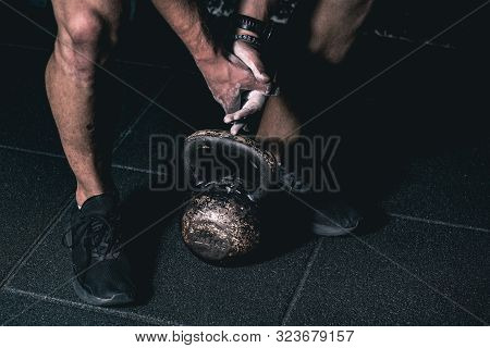 Kettle Bell Training, Strong Muscular Man With Muscles Holding Heavy Red Kettlebell With His Hand On