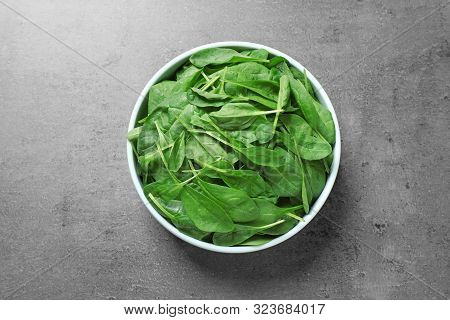 Fresh Green Healthy Spinach On Grey Table, Top View